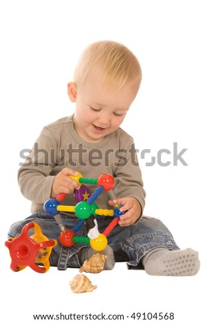 little boy play with toys. isolated on a white background