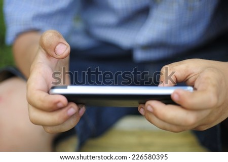 Little boy playing a game on the smartphone