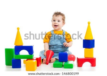 little boy playing building blocks - stock photo