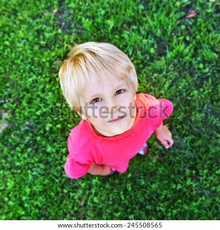 little boy playing in park - stock photo