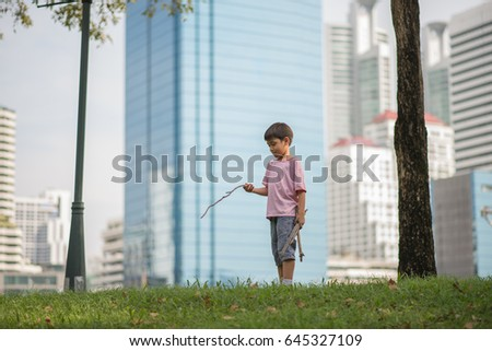 Little boy playing in the city park