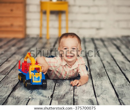 little boy playing in the room - stock photo