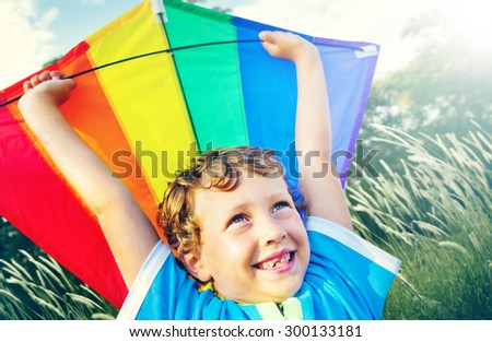 Little Boy Playing Kite Park Windy Concept - stock photo