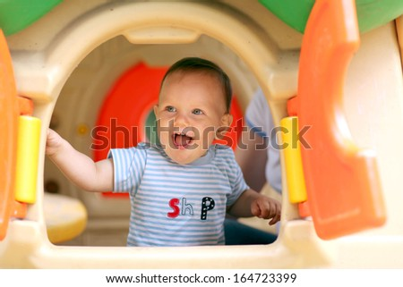 little boy playing on the playground - stock photo