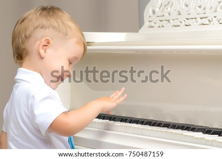 Little boy playing piano at home. Concept of music