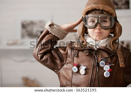 Little boy playing pilot in his room - stock photo