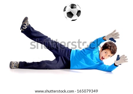 little boy playing soccer isolated in white - stock photo