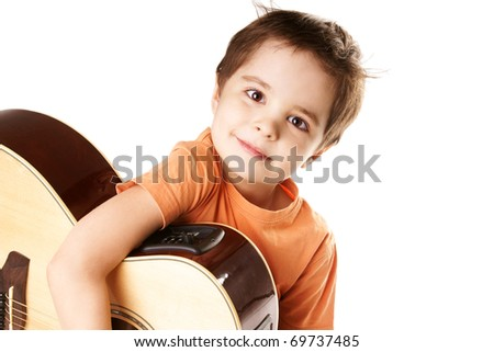 Little boy playing the guitar isolated on a over white background - stock photo