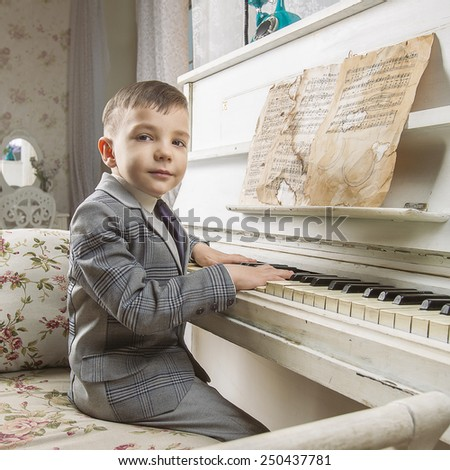 Little boy playing the piano - stock photo