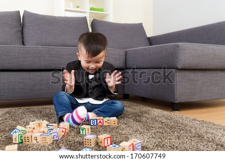 Little boy playing toy block - stock photo