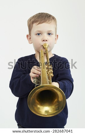 little boy playing trumpet.music child.musical instrument - stock photo