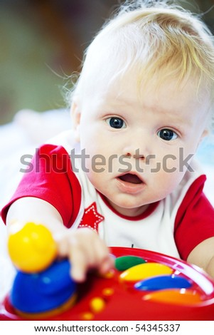 little boy playing with a music toy - stock photo