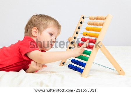 little boy playing with abacus, early learning - stock photo