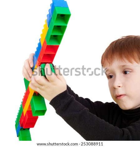 little boy playing with bricks - stock photo