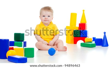 little boy playing with building blocks - stock photo
