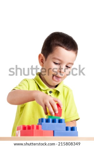 Little boy playing with colorful block toys. - stock photo