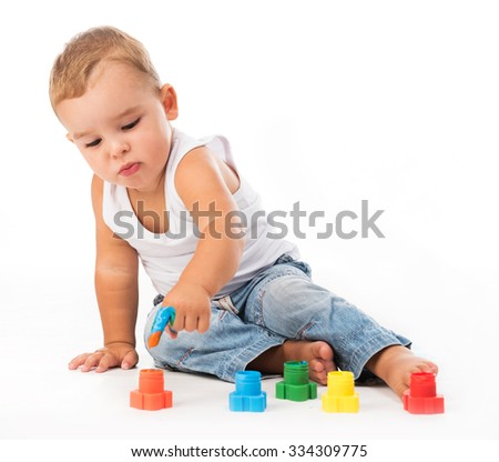 little boy playing with gouache isolated on white background - stock photo