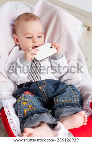 Little boy playing with phone