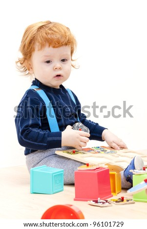 little boy playing with puzzle
