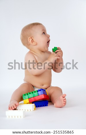 Little boy playing with toys sitting