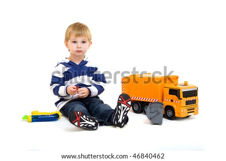 little boy playing with truck isolated on white