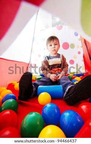 little boy plays in tent