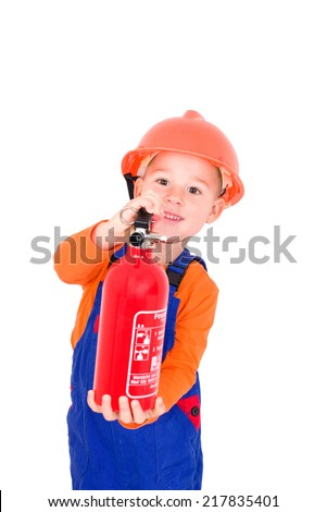 little boy plays with a fire extinguisher Firefighter  - stock photo