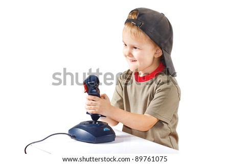 Little boy plays with a joystick on a white background - stock photo