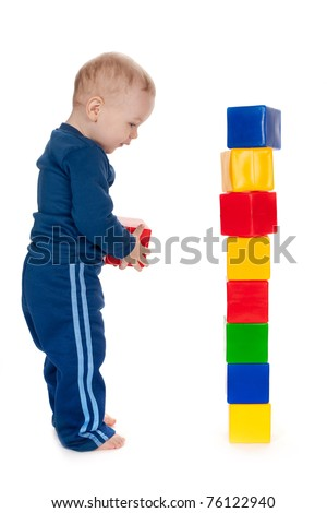 little boy plays with cubes isolated - stock photo