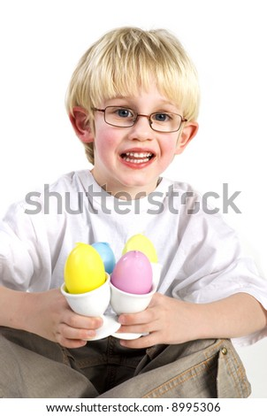 Little boy plays with easter eggs - stock photo