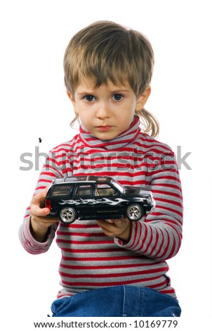 Little boy plays with his black toy car
