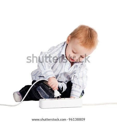 little boy plays with plug - stock photo
