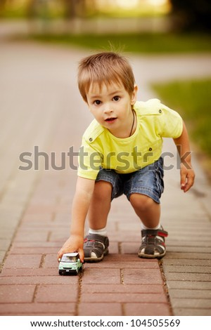 little boy plays with toy car - stock photo