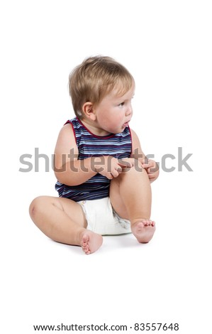 Little boy pointing to his scraped knee. Isolated on white - stock photo