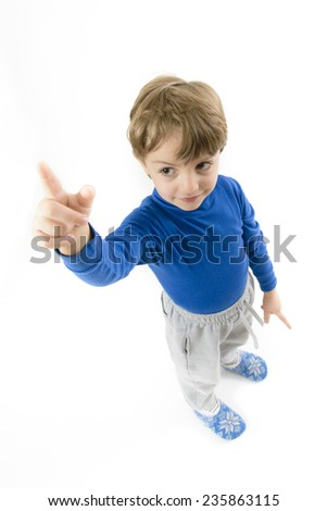 Little Boy Pointing Upwards isolated on white - stock photo