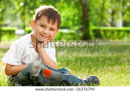 little boy portrait in the park - stock photo