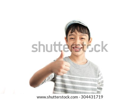 Little boy pose portrait with thump up on white background - stock photo