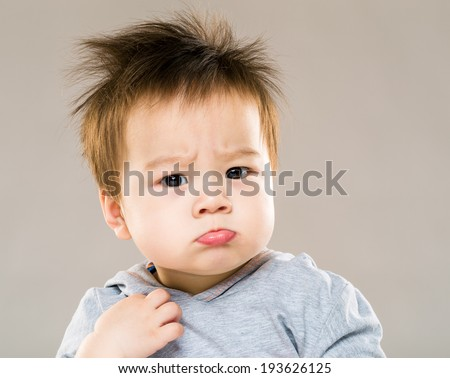 Little boy pouting - stock photo
