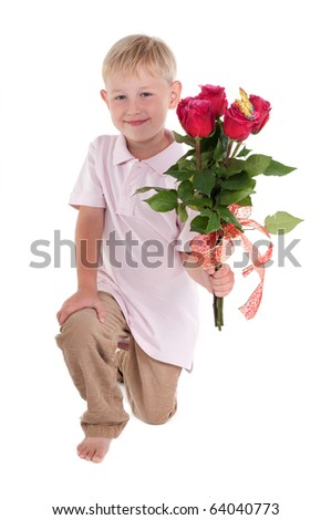 Little boy presenting a red rose bouquet