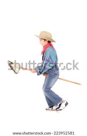 little boy pretending to be a cowboy isolated in whiet - stock photo