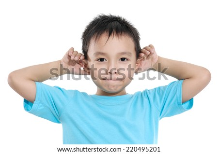Little boy pulling a funny face isolated - stock photo