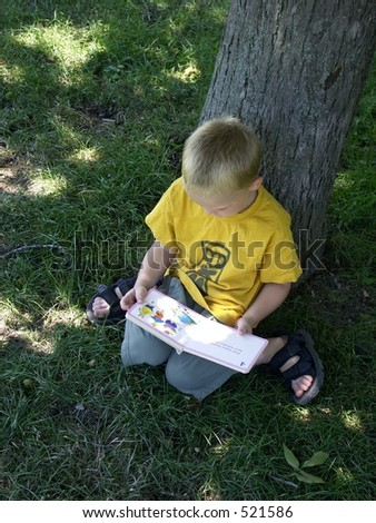 little boy reading - stock photo