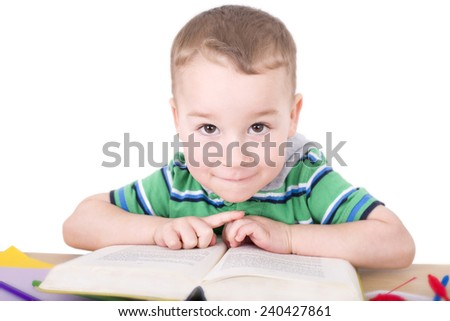 little boy reading a book