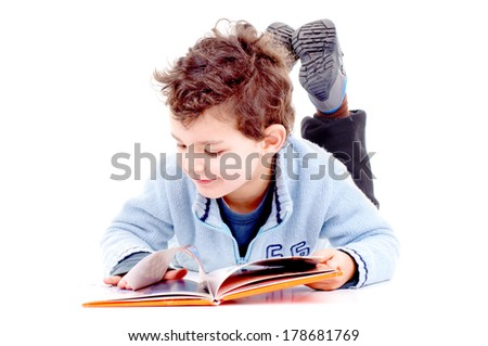 little boy reading a book isolated in white - stock photo