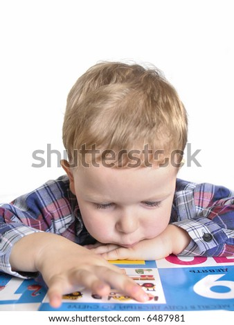 little boy reading a book isolated on a white background