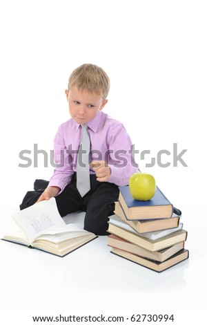 Little boy reading a book. Isolated on white - stock photo