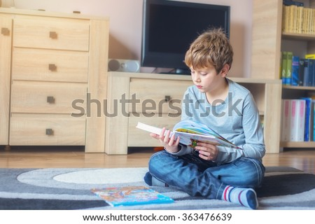 Little boy reading a fairy tale