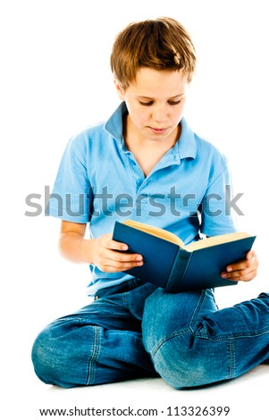 little boy reading book isolated on a white background - stock photo