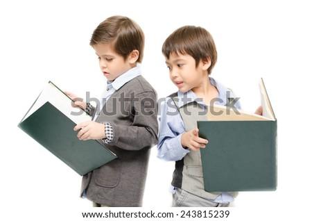 Little boy reading books on white background - stock photo