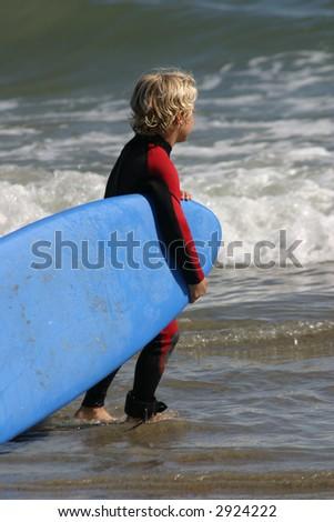 Little boy ready for surfing on Malibu Beach, California - stock photo